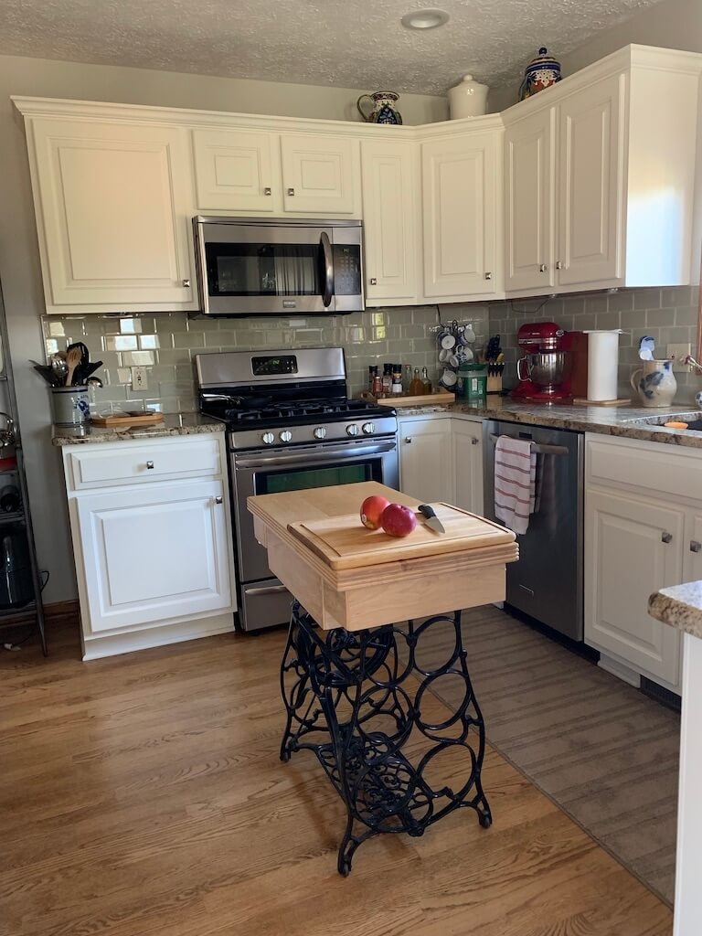 kitchen cabinets and wine table island